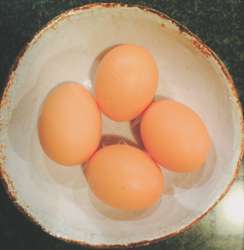 Eggs in a white artisan eatware dish