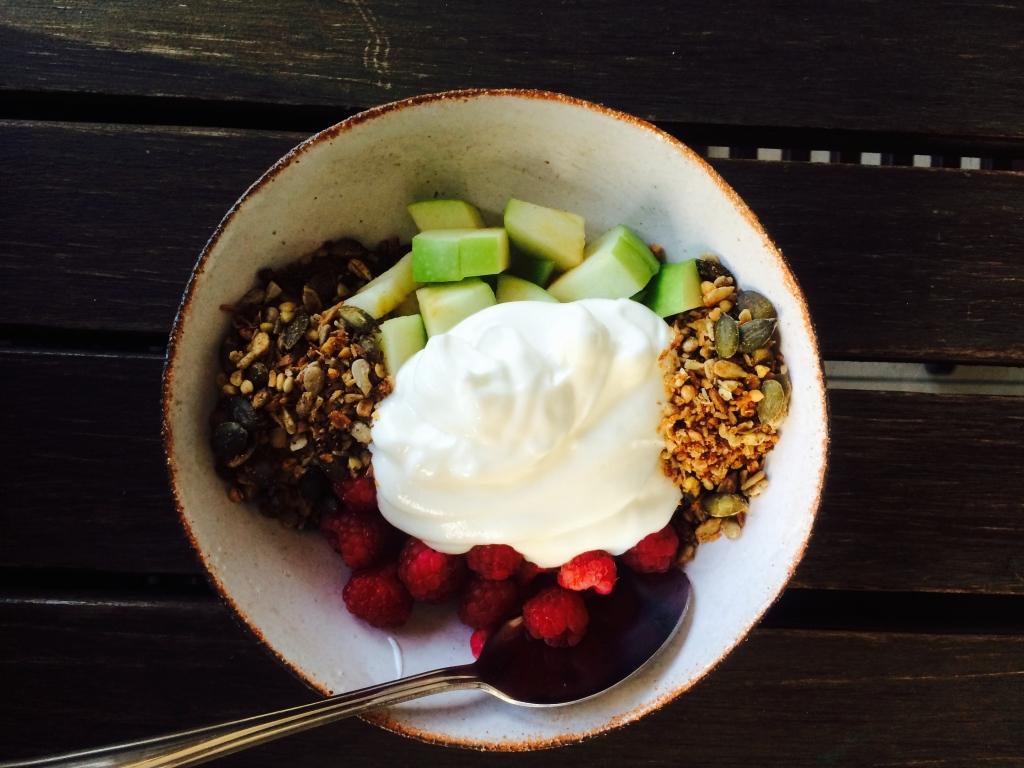 Home-made muesli, Greek yoghurt, apple and raspberries.