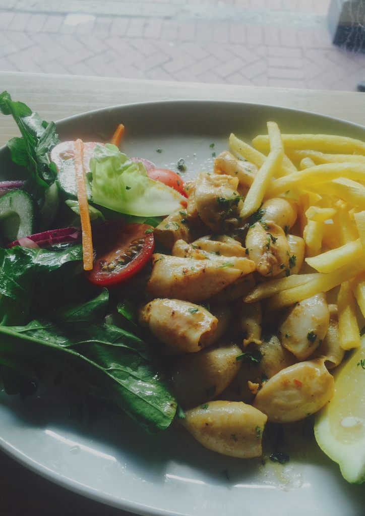 Grilled Calamari and side salad at the Bootlegger in Cape Town